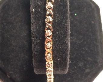 10k gold ZRW XO with 28 diamond  bracelet