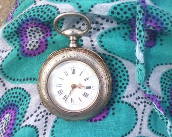 a Silver Pocket Watch end August cocquard