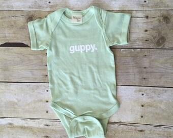 Pastel organic guppy baby onesie