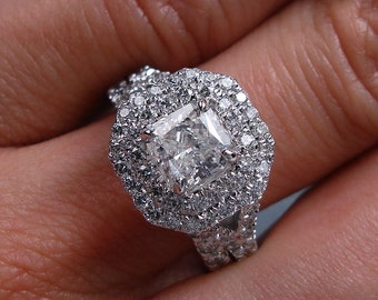 Stunning 2.15 ctw Radiant cut diamond ring and wedding band set with an tantilizing 0.91 ct G/SI1 Clarity Enhanced Radiant cut diamond