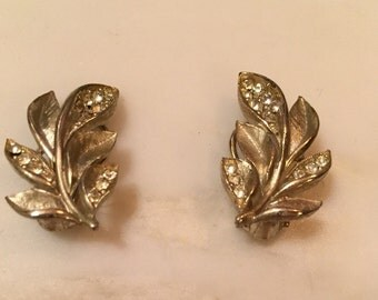 Vintage silver tone rhinestone leaf earrings