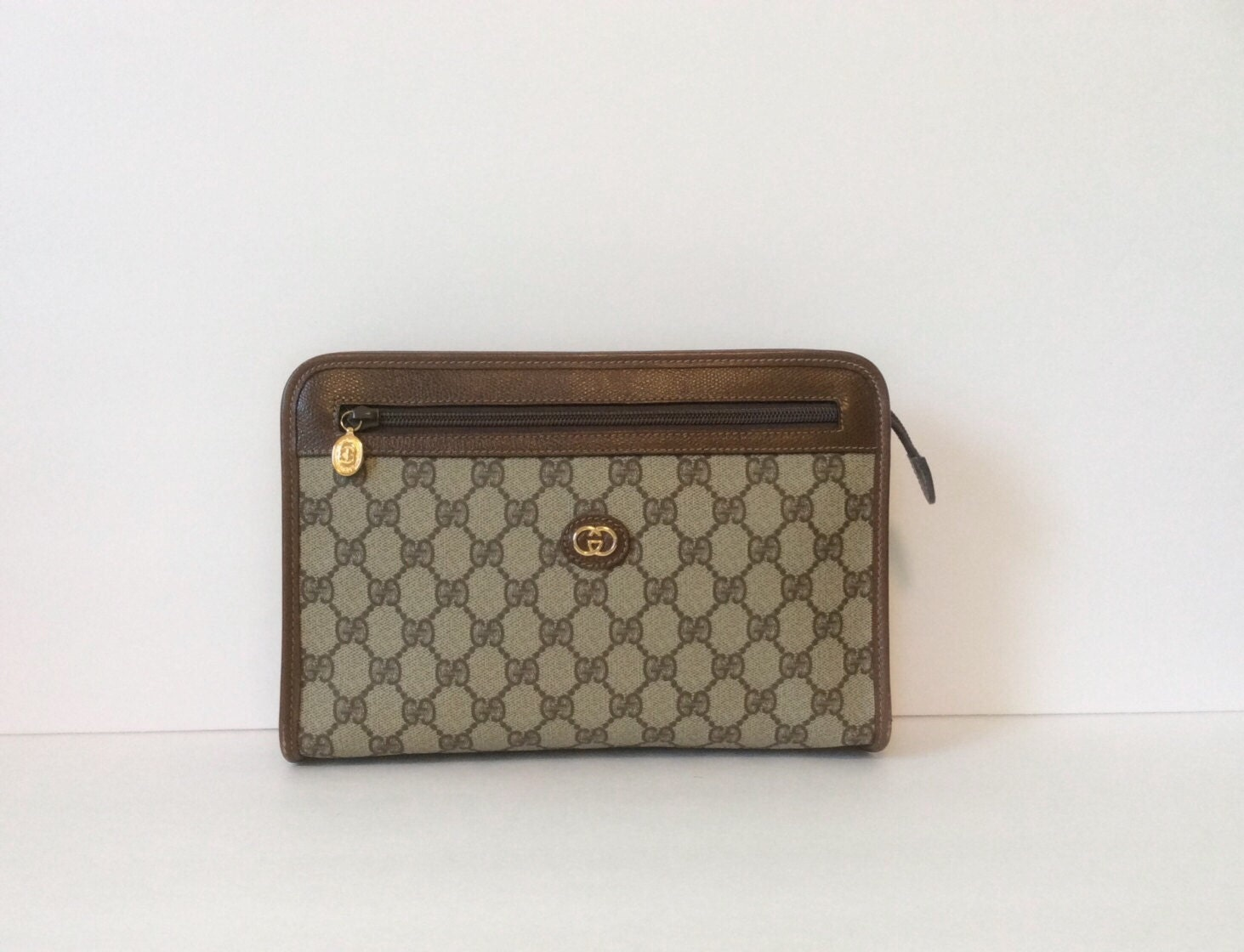 af6cc1964e7a3a Ultimate Guide on How to Tell if a Gucci Bag is Real (or Fake) Vintage Gucci  clutch // Gucci GG logo zip top by VintieSweetheart