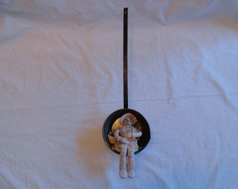 Unique Folk Art of A Fisherman Made Out of Shells Sitting Inside A Vintage Water Drinking Ladle