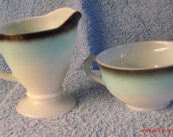 "Cup and and creamer made by the ""Hazel Atlas Glass Co."""