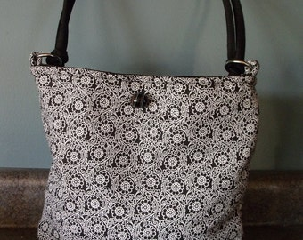 Purse, black and white with black lining. Light weight and machine washable.