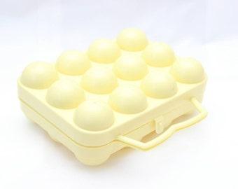 Box yellow plastic egg