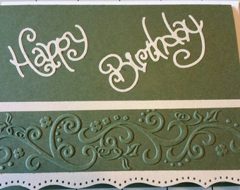 Birthday card with embossed border.