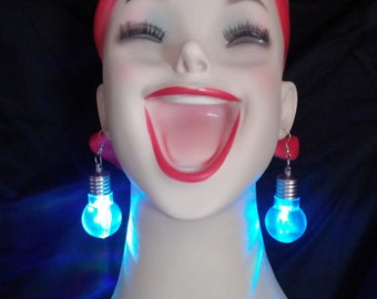Light bulb earrings! Flash your personality without getting arrested. Light your way through boredom with light up fashion.