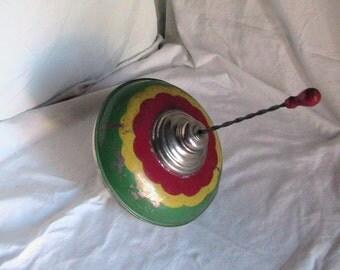 Vintage 1960's Red Yellow Green Metal Whirligig Spinning TopToy