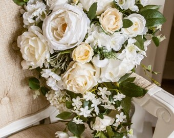 Natural white and cream silk teardrop wedding bouquet. Made with artificial roses, peonies and blossom.