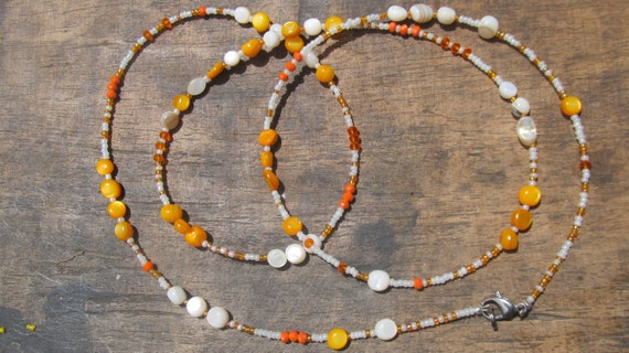 VERANO custom made waist beads, glass beads, creamy and orange dyed natural stones, ivory white and orange seed beads, crystals, Trade Fair