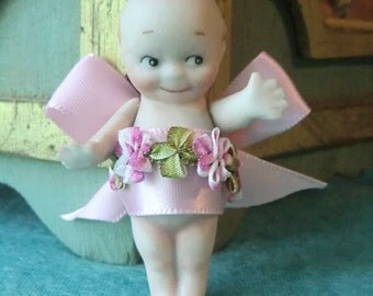 "3"" Bisque Kewpie with a bow"