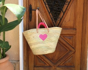 Big Beautiful Straw Bag with a heart and embroidered handles.