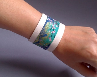 Bracelet typifies cuff in white leather and blue Japanese flowers fabric
