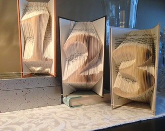 Numbers, 1 or 2 digits, shadow books, folded book art