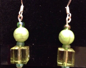 Green crystal cubes topped by green veined spheres on gold wires
