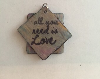 Double panel all you need is love pendant