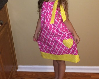 Hot pink and yellow pillowcase dress with yellow heart appliqué