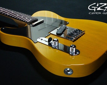 Left-handed Electric Guitar w/transparent Butterscotch finish