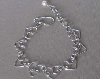 Sterling Silver Heart Chain Bracelet - Chain of Hearts - Handmade Heart Links - 6 1/4 Inch Plus 1 1/4 Inch Extension w/ Single Pearl Dangle