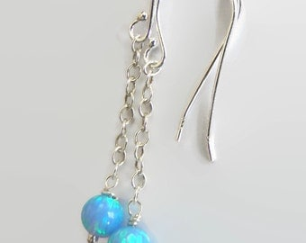 Opal earrings. Sterling silver chain and earwires. 5mm beads brilliant from Israel.