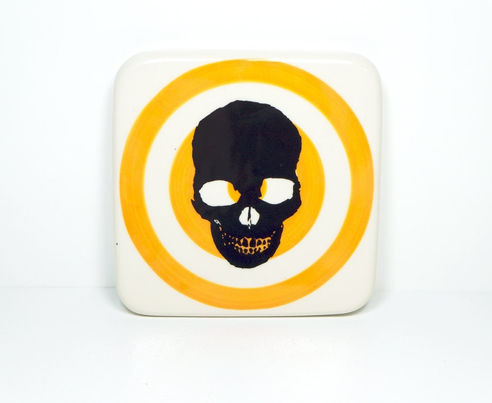 tile with a skull silhouette on a creamsicle bullseye, made to order.