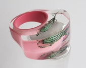Pink lucite ring with real beetle