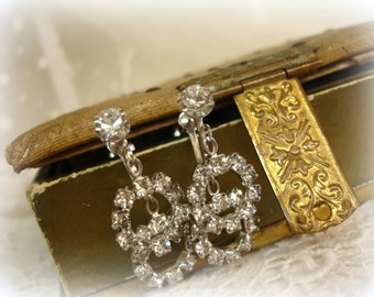 vintage rhinestone earrings . mostly bRilliant rhinestones screw backs prong set circle dangles