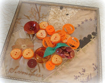 assorted vintage buttons in shades of oRange . plastics . celluloid . vegetable ivory sets and orphans