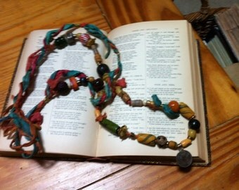 Vintage African trade beads and fiber necklace