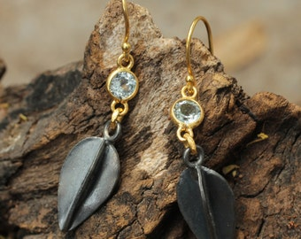 Sterling silver earrings with 24k gold plated silver highlights and blue topaz gemstones