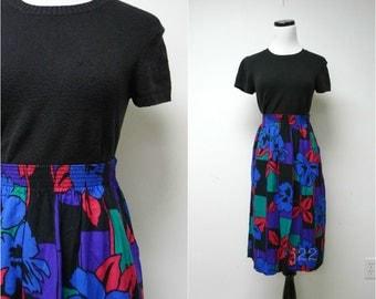 "JESSICA . bold print skirt . size 12 / waist: 25"" - 34"" . made in USA"