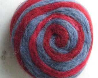 One multi-colored felted pin-cushion, Red and Blue