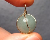Caged Magic Materia in Gold - Freestyle 14kt Gold Wire-Wrapped Natural Green Jade Pendant