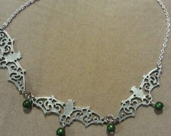 Silver tone Scroll Bat Choker with deep green beads
