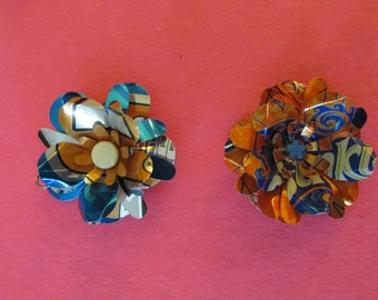 Recycled soda can flower pendants