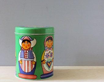 Vintage German tin container, matryoshka dolls.