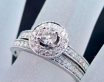 Halo style 14K white gold and diamond wedding/bridal set. .80 carats TW
