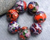 Magdalena Ruiz, purple set of handmade lampwork beads, SRA