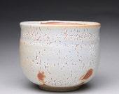 handmade matcha chawan, tea bowl, ceramic bowl with orange and crackle white shino glazes
