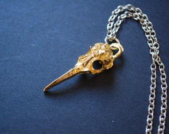 gold tone bird skull necklace