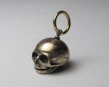 Bronze embryo skull large