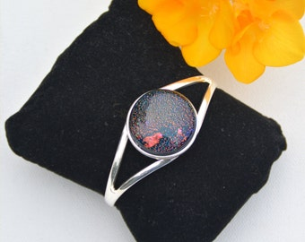 Silver plated over copper cuff bracelet with round multi color cabochon