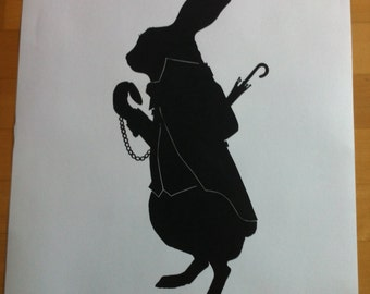 """Oversized Alice in Wonderland White Rabbit, just rabbit silhouette is 20""""x10"""", pasted on 27""""x19"""" white cardstock"""