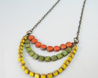 Citrus yellow green and orange Czech glass beads on natural brass by CURRICULUM