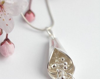 Beautiful organic sterling silver and fine silver kinetic pendant