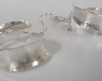 Silver anticlastic hoop earrings Argentium ear wires lots of movement