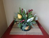 Christmas Floral arrangement with winter greens and pears
