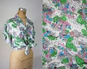 reserved // vintage 1940s blouse / 40s novelty print rayon blouse / 40s short sleeve top / 40s button down shirt / 40s parisian market blous