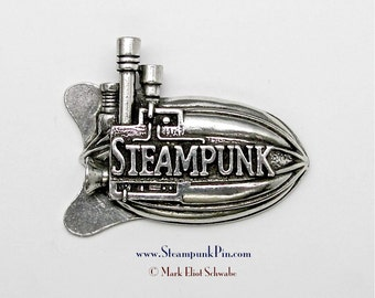 "Steampunk pin, the word ""Steampunk"" front & center - declare your style! This Airship has 3 smoke stacks lots of detail - pewter double tac"